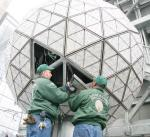 Workers install some of the 2668 Waterford Crystal triangles on the 2009 Times Square Ball.