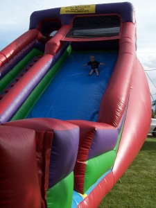 The giant the inflatable slide with my little guy coming down!