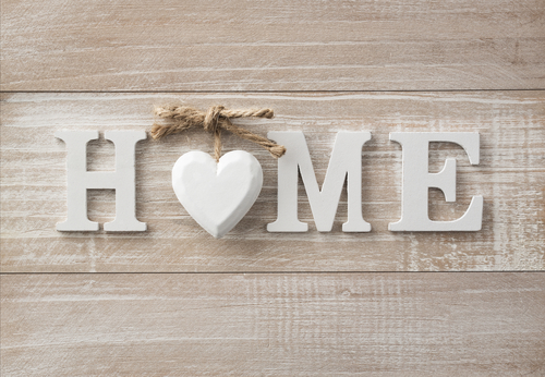 Home sweet home, wooden text on vintage board background with co